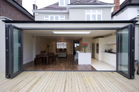 convert your old conservatory into a modern orangery, bifold doors with french doors in the centre, aluminium bifold doors, modern kitchen, orangery extension, orangery kitchen extension